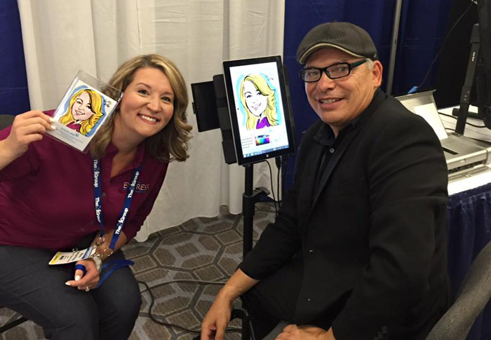 The digital caricature artist and conference attendee