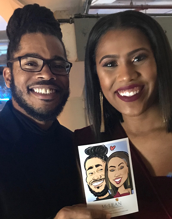 Smiling guests holding their digital caricature