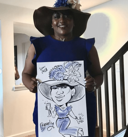 Stylishly dressed lady poses with her caricature